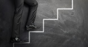 Climbing at the career stairs drawn on a chalkboard