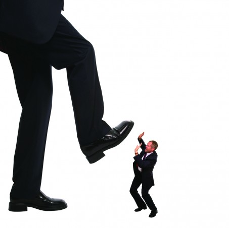 Concept image of an employee about to be stepped on by his manager.