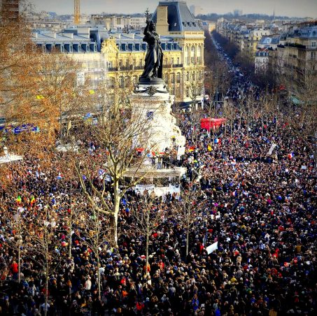 "People gather on the Place de la Republique (Republic Square) in Paris before the start of a Unity rally ""Marche Republicaine"" on January 11, 2015 in tribute to the 17 victims of a three-day killing spree by homegrown Islamists. The killings began on January 7 with an assault on the Charlie Hebdo satirical magazine in Paris that saw two brothers massacre 12 people including some of the country's best-known cartoonists, the killing of a policewoman and the storming of a Jewish supermarket on the eastern fringes of the capital which killed 4 local residents. AFP PHOTO / BERTRAND GUAY"