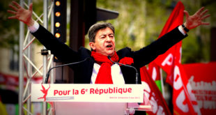 "French far-left Parti de Gauche (PG) leader Jean-Luc Melenchon delivers a speech during a demonstration in Paris, May 5, 2013. The far-leftist Parti de Gauche called for a demonstration on Sunday against austerity and for the establishment of a ""sixth republic"", which includes diminishing the power of the president and increasing the parliament's authority, on the eve of the first anniversary of the election of French President Francois Hollande. The slogan on the podium reads, ""For the sixth republic"". REUTERS/Charles Platiau (FRANCE - Tags: POLITICS CIVIL UNREST BUSINESS) - RTXZBFR"